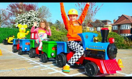 Katy and Max build railway for kids ride on train