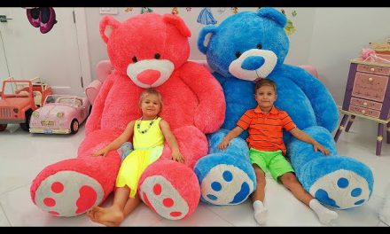Diana and Roma play with Giant Teddy Bear