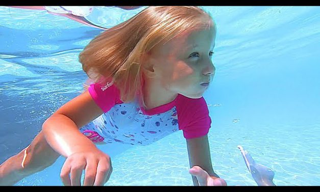 Baby girls play at Amusement & Water Park with Slide and Swimming pool