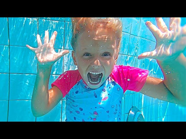 Kids have fun playtime at waterpark with Giant water slides and swimming pool
