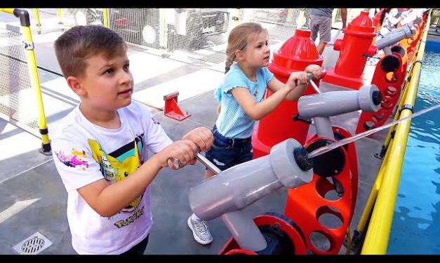 Diana and Roma interact with fun exhibits at the Legoland